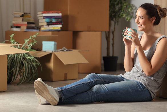 young woman in an apartment she's renting